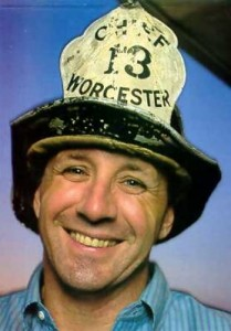 Photo of Nat Benchley in his grandfather's Fire Chief helmet