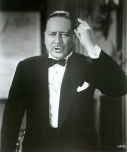 Robert Benchley (or is it Nat Benchley?) making a point...or sneezing...or...well, something is  going on.